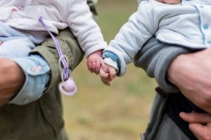 need for intimacy represented by children touching hands